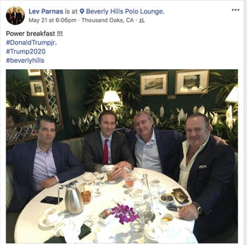 This Facebook screen shot provided by The Campaign Legal Center shows, from left, Donald Trump Jr., Tommy Hicks Jr., Lev Parnas and Igor Fruman, posted on May 21, 2018.