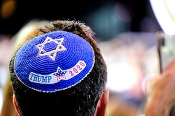 A man wearing a yarmulke supporting Donald Trump as the U.S. president speaks at the Israeli-American Council Summit in Hollywood, Florida, December 7, 2019.