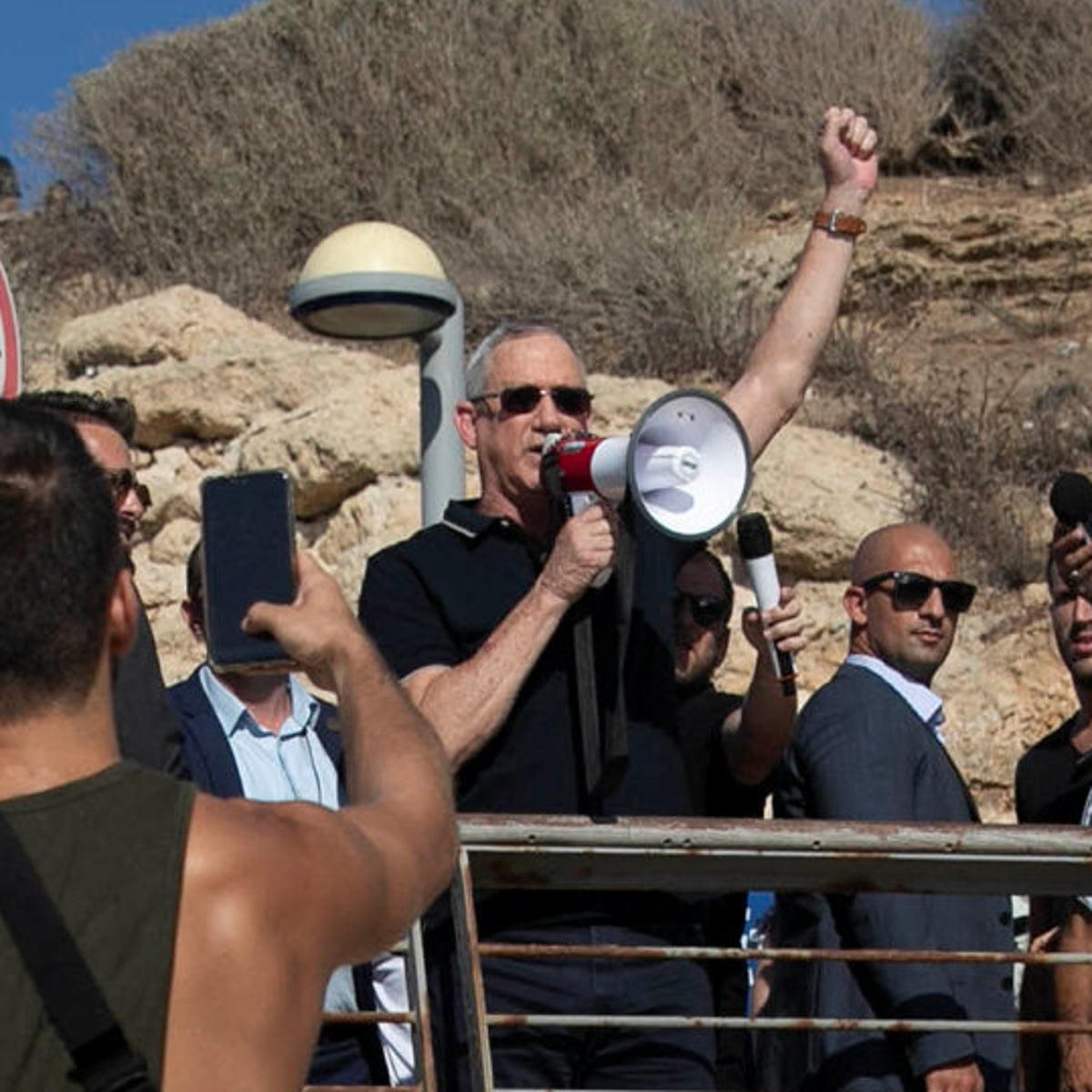 Benny Gantz, center behind, is surrounded by Tel Avivians at a local beach, during his latest election campaign.