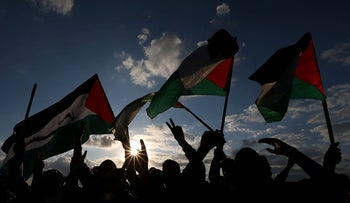 Demonstrators hold Palestinian flags during an anti-Israel protest at the Israel-Gaza border fence, in the southern Gaza Strip, December 6, 2019.