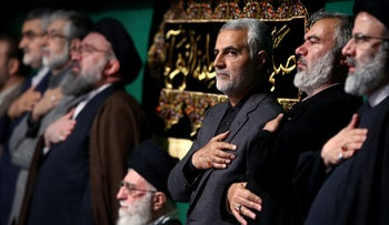 Iran's supreme leader Ayatollah Ali Khamenei (C) with Gen. Qasem Soleimani (3rd from R), attending a religious ceremony in Tehran, March 27, 2015.