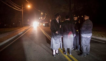 Orthodox Jews close to the scene of a stabbing attack that occurred during a Hanukkah celebration in Monsey, N.Y., on Sunday, December 29, 2019.