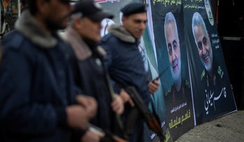 Palestinian Hamas policemen stand guard next to posters of Qassem Soleimani in front of a mourning tent held by Palestinian factions in Gaza City, Jan. 4, 2020.