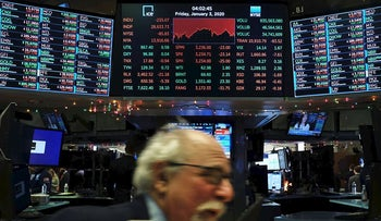 Traders work on the floor of the New York Stock Exchange (NYSE) on January 03, 2020 in New York City