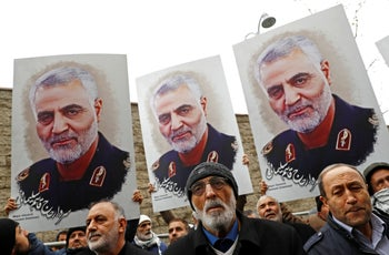 Demonstrators hold placards depicting Soleimani during a protest, outside U.S. Consulate in Istanbul, January 5, 2020.