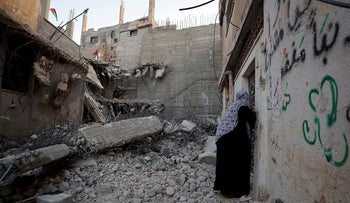 A woman checks the family house of Palestinian assailant Islam Abu Humaid after it was demolished by Israeli forces, in El Amari refugee camp in Ramallah in the Israeli-occupied West Bank, October 24, 2019