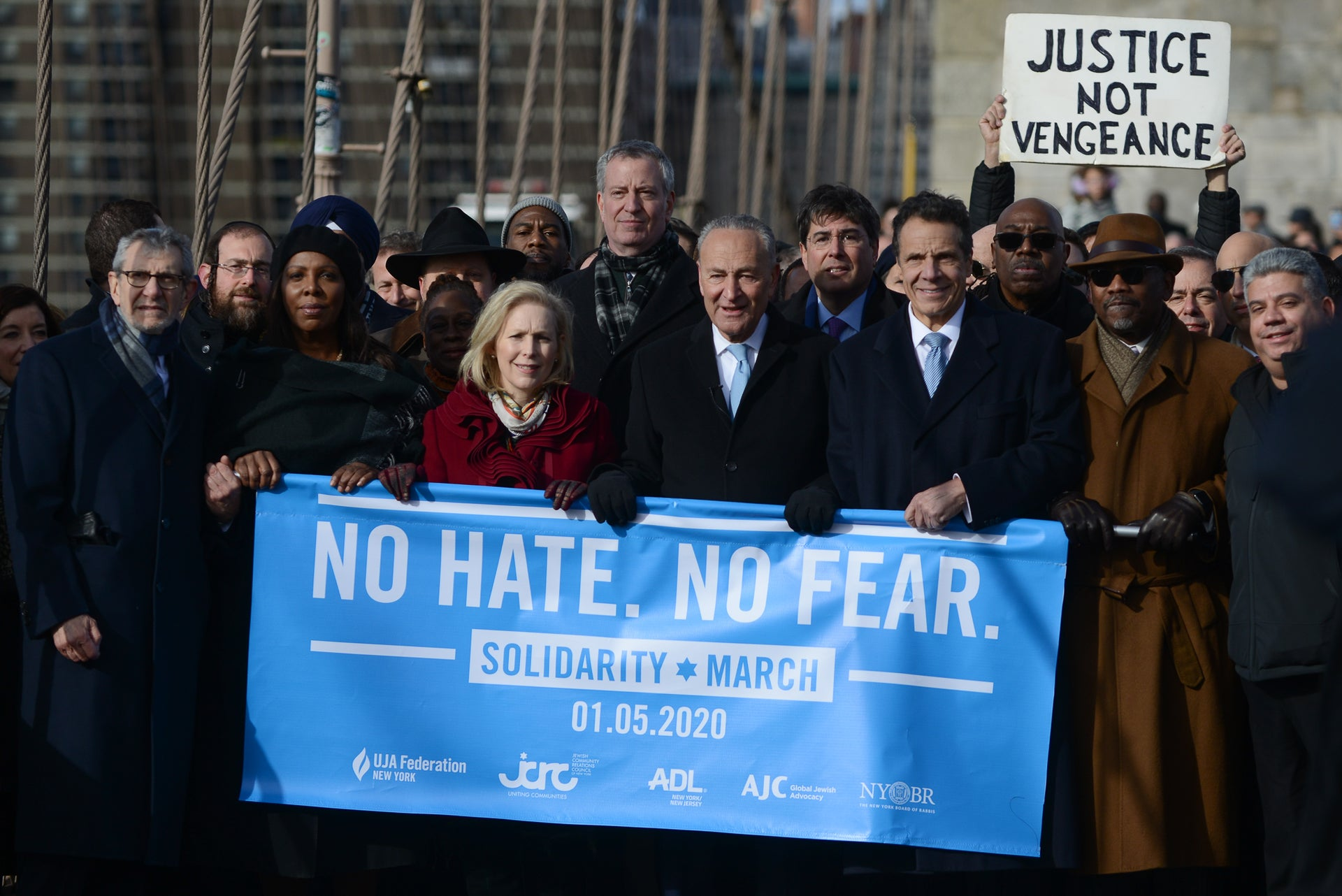 Political figures, including U.S. Senate Minority Leader Chuck Schumer (C), participate in a march against anti-Semitism, New York City, January 5, 2019