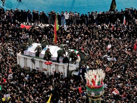 Coffins of Qassem Soleimani and others who were killed in Iraq by a U.S. drone strike, are carried on a truck surrounded by mourners during a funeral procession in Tehran, January 6, 2020.