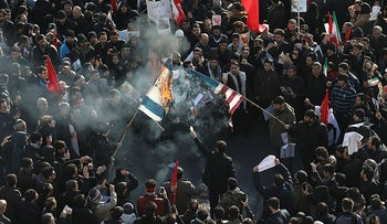 Mourners burn flags of the U.S. and Israel during a funeral for Iranian Gen. Qassem Soleimani at the Enqelab-e-Eslami square in Tehran, Iran, January 6, 2020.