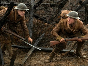 This image released by Universal Pictures shows Dean-Charles Chapman, left, and George MacKay in a scene from '1917,' directed by Sam Mendes.