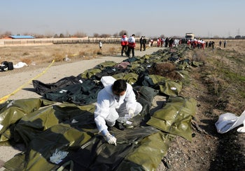 Passengers' dead bodies in plastic bags at the site where the Ukraine International Airlines plane crashed, on the outskirts of Tehran, Iran January 8, 2020.