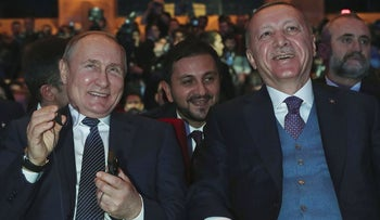 Turkish President Recep Tayyip Erdogan, right, and Russian President Vladimir Putin smile during a ceremony for the dual natural gas line, TurkStream, connecting their countries, in Istanbul, Wednesday, Jan. 8, 2020
