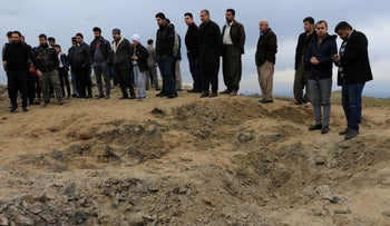 Residents look at a crater caused by a missile launched by Iran on U.S.-led coalition forces on the outskirts of Duhok, Iraq, January 8, 2020.