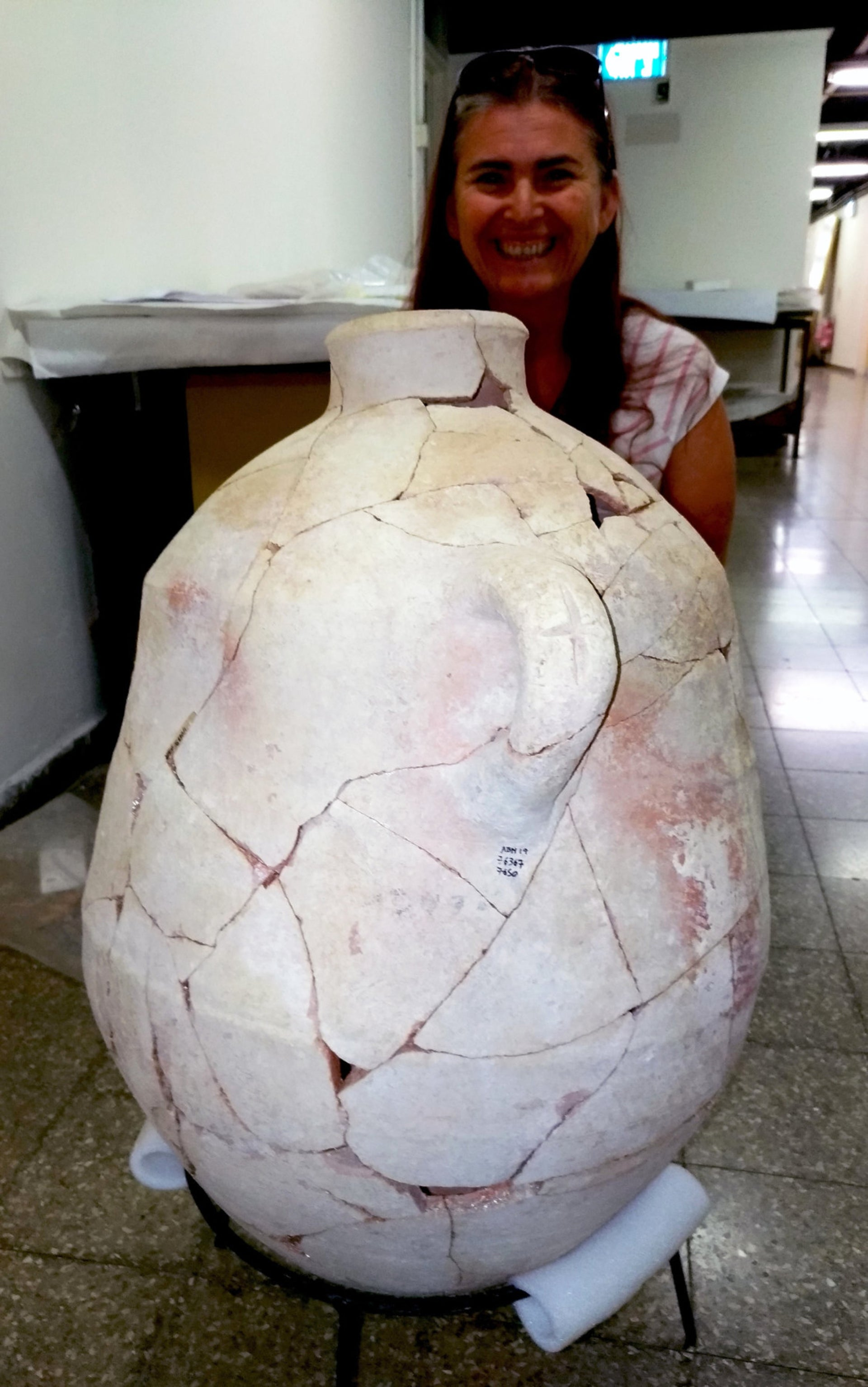 Restorer Adrienne Ganor poses with the inscribed jar found at Abel Beth Maacah