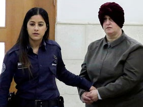 Accused sex offender Malka Leifer, right, is brought to a courtroom in Jerusalem, February 27, 2018.