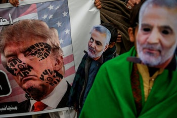 Shiite Muslims wear masks of Iranian commander Qasem Soleimani during a protest against the US strike that killed Soleimani in Iraq, in Islamabad on January 5, 2020