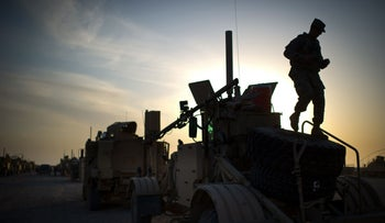 A U.S. soldier inspects preparations for a convoy to leave Iraq from Camp Adder on the outskirts of the southern Iraqi city of Nasiriyah, December 17, 2011.