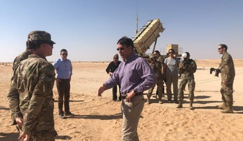 U.S. Defense Secretary Mark Esper speaks with U.S. troops in front of a Patriot missile battery at Prince Sultan Air Base in Saudi Arabia, October 22, 2019.