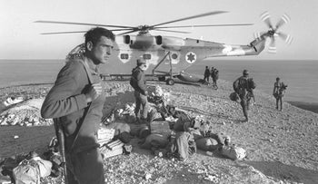 Soldiers board an IDF helicopter during the War of Attrition, 1970.
