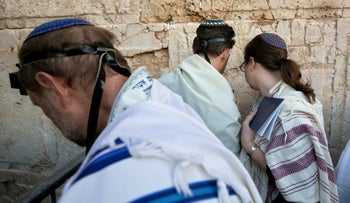 In this , Feb. 25, 2016 file photo, American and Israeli Reform rabbis pray at the Western Wall in Jerusalem.