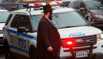 A NYPD car patrols in South Williamsburg Brooklyn on December 30, 2019 in New York City