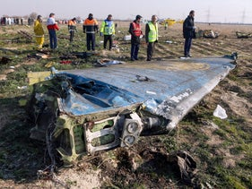 Rescue teams are seen at the scene of a Ukrainian airliner that crashed shortly after take-off near Imam Khomeini airport in Tehran, Iran, January 8, 2020