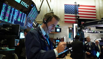A trader works at the New York Stock Exchange (NYSE) in New York, U.S., January 2, 2020.