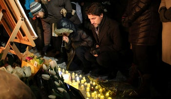 Justin Trudeau Prime Minister of Canada place a candle on Parliament Hill during vigil for the victims who were killed in a plane crash in Iran, January 9, 2020.