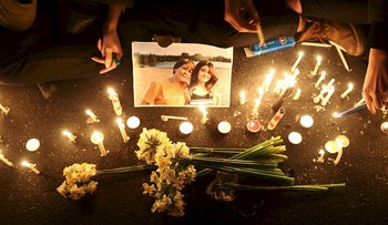 People and families of the victims of the crash of the Boeing 737-800 plane, flight PS 752, light candles as they gather to show their sympathy in Tehran, Iran January 11, 2020