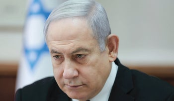 Benjamin Netanyahu chairs the weekly cabinet meeting at his office in Jerusalem on December 1, 2019.
