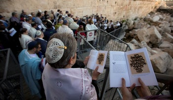 In this Feb. 25, 2016 file photo, American and Israeli Reform rabbis pray at the Western Wall in Jerusalem.