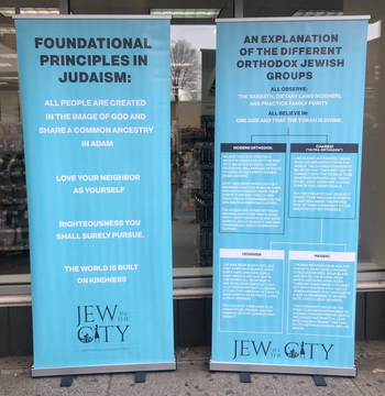 A 'Jew in the City' placard outside a tent set up to talk to residents in East Harlem, New York, January 13, 2020