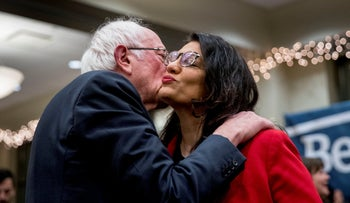 Democratic presidential candidate Sen. Bernie Sanders, left, and Rep. Rashida Tlaib kissing after he spoke at a campaign stop at St. Ambrose University, Davenport, Iowa, January 11, 2020.