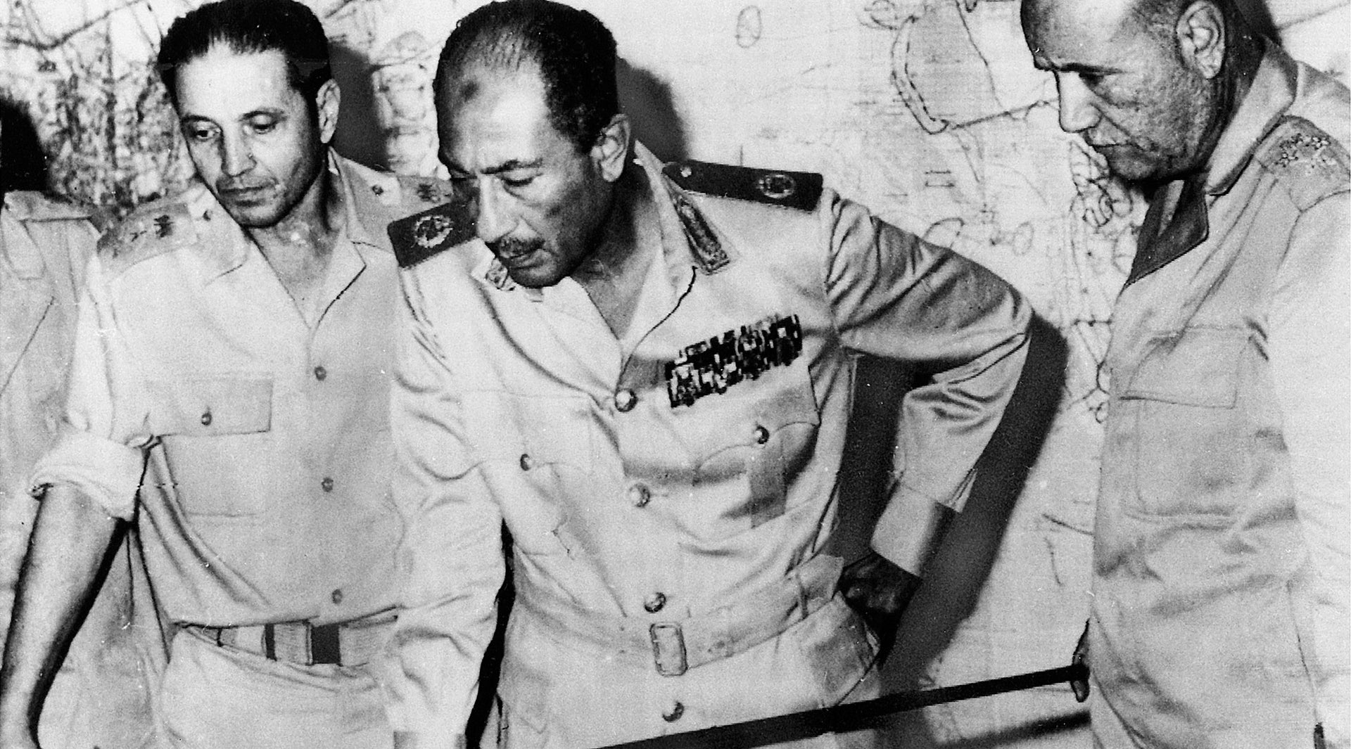 Egypt's Chief-of-Staff Saad el-Shazly (left), President Anwar Sadat  (center) and Minister of War Ismail Ali review battlefield developments in 1973.