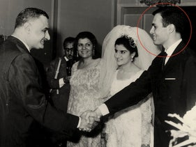 Ashraf Marwan, at his wedding, shakes hands with Egyptian President Gamal Abdel Nasser, the father of the bride, July 7, 1966.