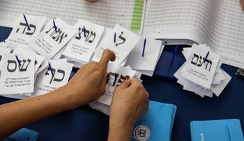 Counting ballots in the September 2019 election.