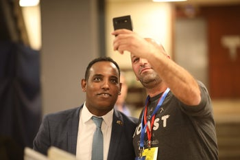 Gadi Yevarkan, left, posing for a selfie in Jerusalem after an eventful day in which he was booted from Kahol Lavan and was placed 20th on the Likud slate, January 15, 2020.