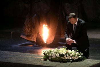 Poland's President Andrzej Duda lays a wreath at the Hall of Remembrance at the Yad Vashem Holocaust memorial in Jerusalem. Tuesday, Jan. 17, 2017