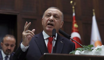 Turkey's President Recep Tayyip Erdogan addresses his ruling party's legislators, in Ankara, Turkey, January 14, 2020