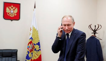 Russian President Vladimir Putin speaking on the phone, Moscow, Russia, December 2019.