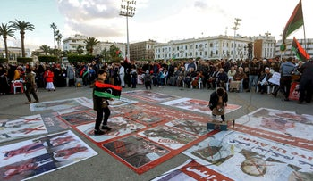 Portraits of Egyptian President Abdel Fattah al-Sissi, Saudi King Salman bin Abdulaziz, and Abu Dhabi Crown Prince Mohammed bin Zayed are displayed on the ground covered with red cross marks as people demonstrate against them and against eastern Libyan strongman Khalifa Haftar, in Tripoli, Libya, in December.