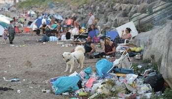 A Lake Kinneret beach is filled with trash during the Passover holiday.