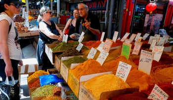 People visit the Shuk HaCarmel, or the Carmel market, in Tel Aviv on May 7, 2019.