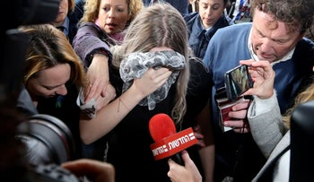 A 19 year-old British woman, center, that was found guilty of making up claims she was raped by up to 12 Israelis arrives at Famagusta District Court for sentencing, January 7, 2020.