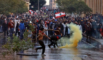 Anti-government demonstrators clash with riot police at a road leading to the parliament building in Beirut, Lebanon, January 18, 2020.