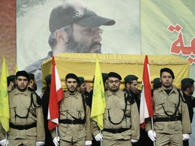 Hezbollah fighters carry the coffin of Hezbollah top commander Imad Mughniyeh, Beirut, Lebanon, February 14, 2008
