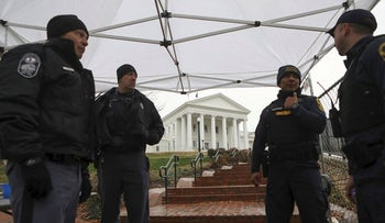 Law enforcement manage a security checkpoint to access the Virginia State Capitol grounds ahead of a gun rights advocates and militia members rally in Richmond, Virginia, U.S., January 18, 2020