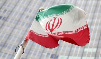 The Iranian flag flutters in front the International Atomic Energy Agency (IAEA) headquarters in Vienna, Austria July 10, 2019.