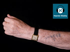 Holocaust survivor Szmul Icek shows his Auschwitz prison number, 117568, on his arm, during a photo session at his home in Jerusalem on December 8, 2019.