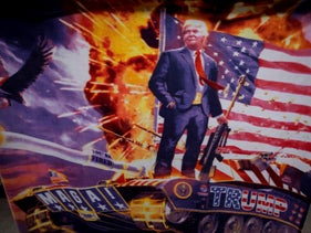 A blanket featuring U.S. President Donald Trump atop a tank and holding a gun hangs near the Huntington Center in Toledo, Ohio on Jan 9th where he is holding his first campaign rally of 2020